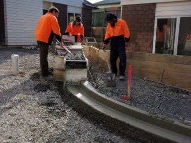 Pouring the concrete for the kerbs