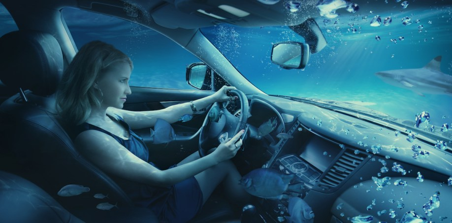 women-car-underwater