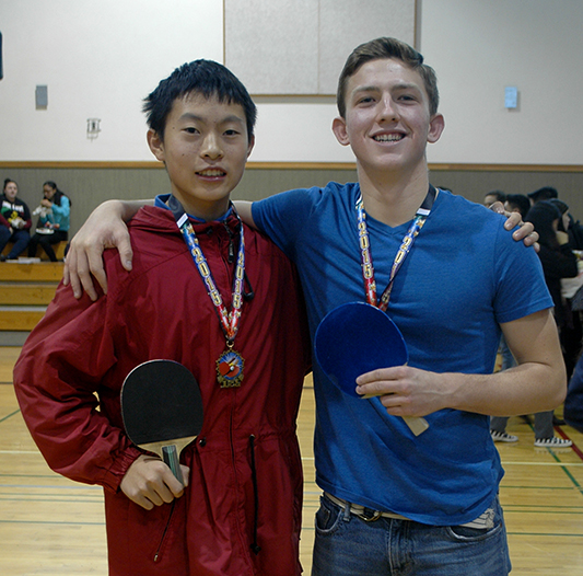 Brian Tognolini and Justin Tat pose for a picture after an intense match. Picture by Nina Bessolo
