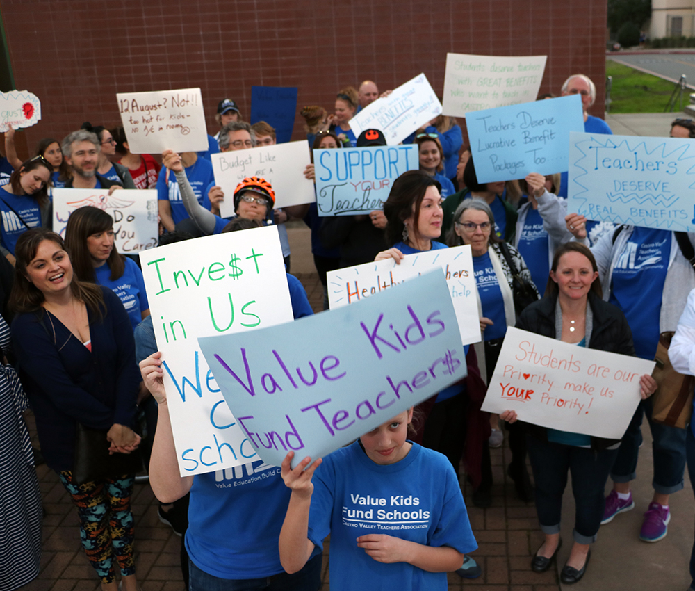 Teachers trek to district office seeking healthcare increase