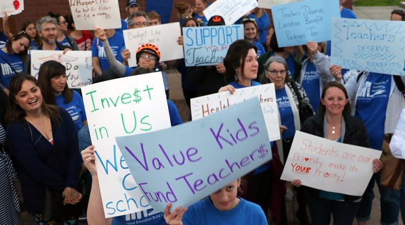 Teachers trek to district office seeking healthcare increase
