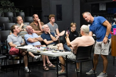 Michael Shaw (far left) and the company of Dezart Performs' Casa Valentina watch as makeup artist James Geier demonstrates makeup techniques on actor Dale Morris. COURTESY OF CLARK DUGGER