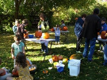 backyard, people carving pumpkins