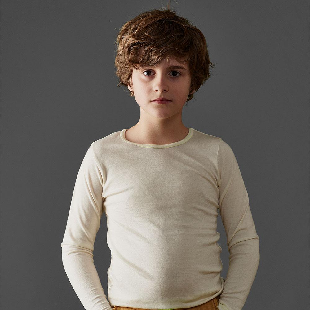 Boy in white Merino wool vest