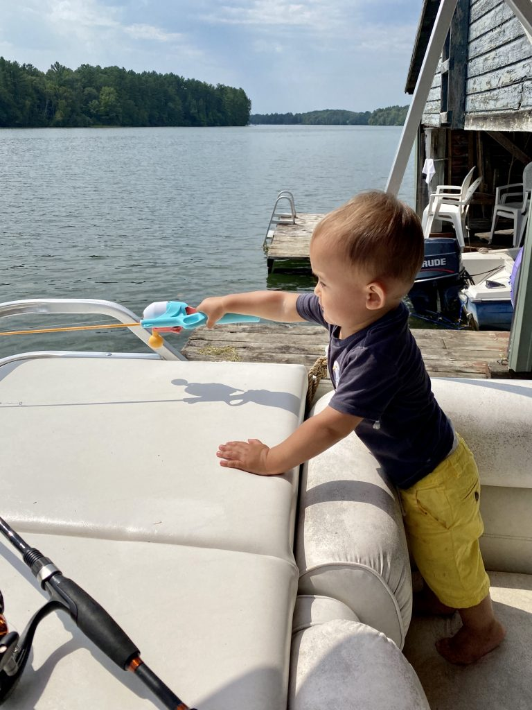 Fishing with a kiddy pole on a docked boat