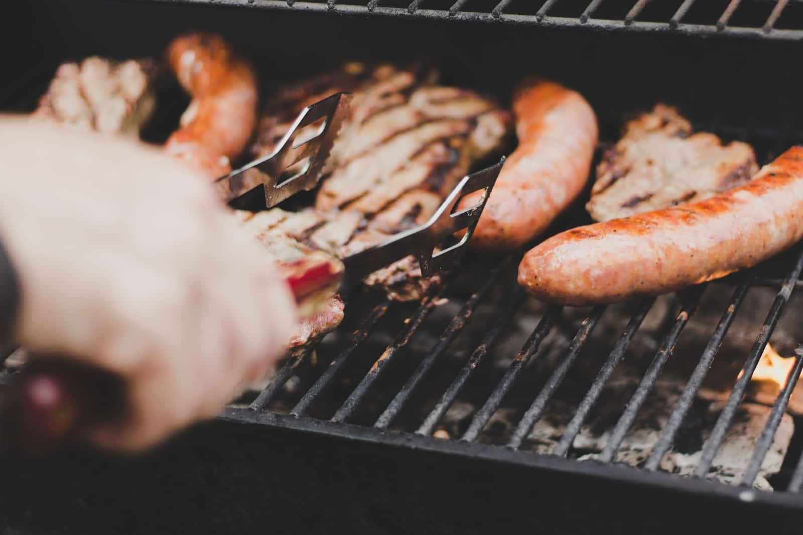 hot dogs and chicken on a grill