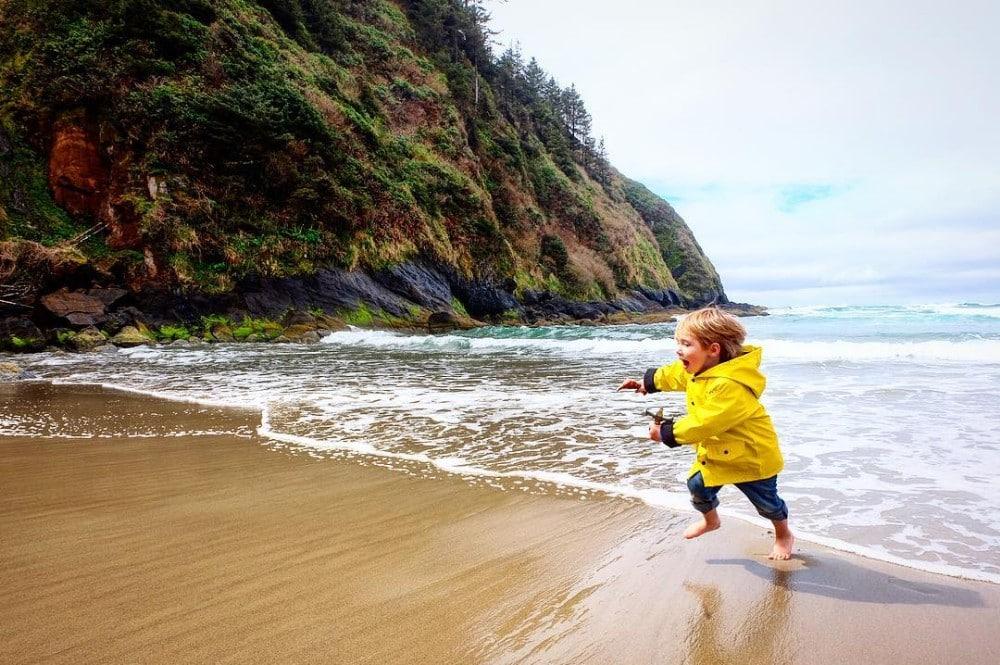 child on a beach along the central Oregon coast