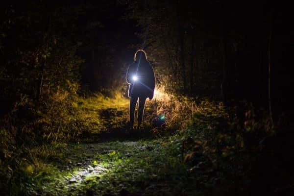 person holding a bright flashlight