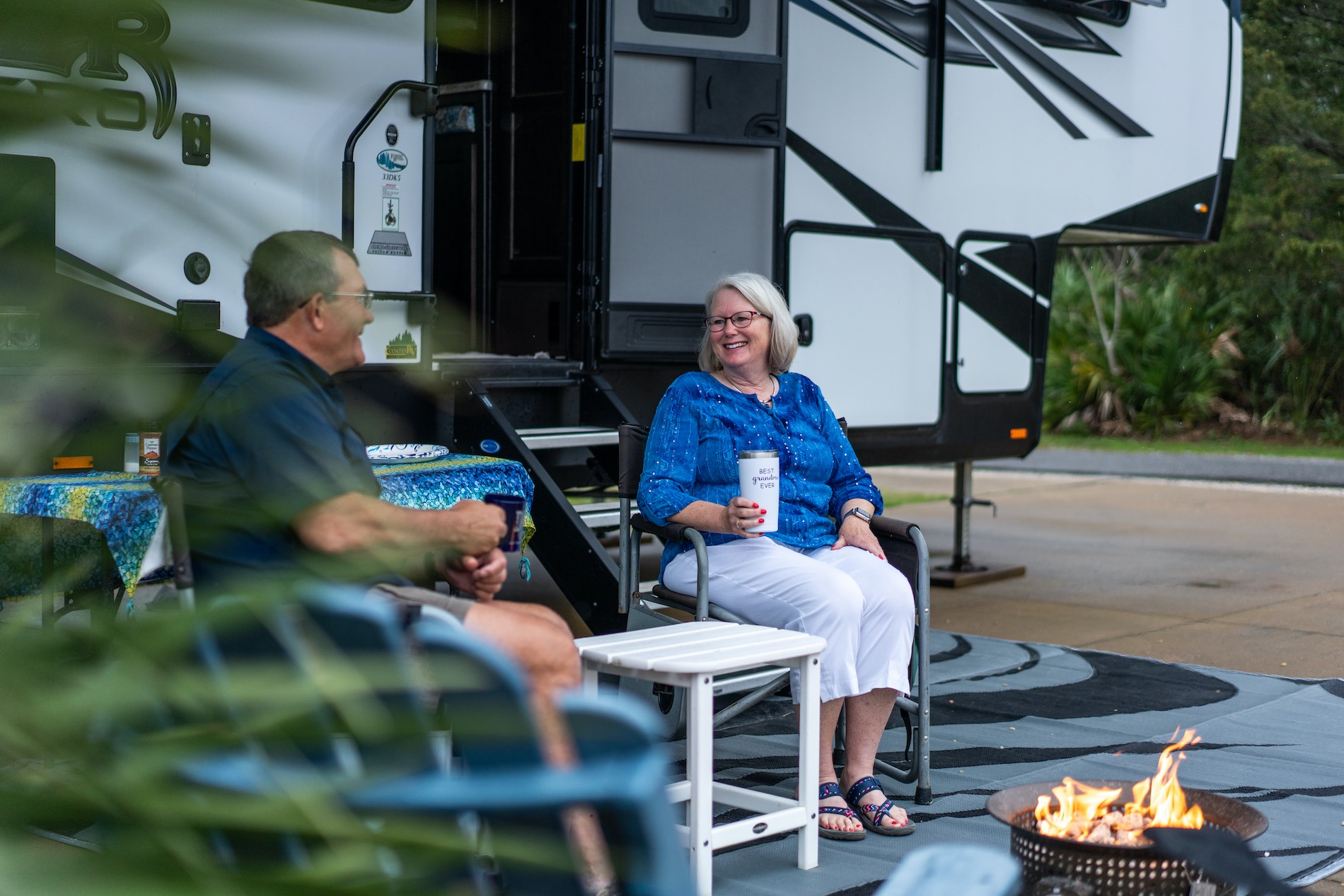 The Mobergs sitting comfortably outside their camper