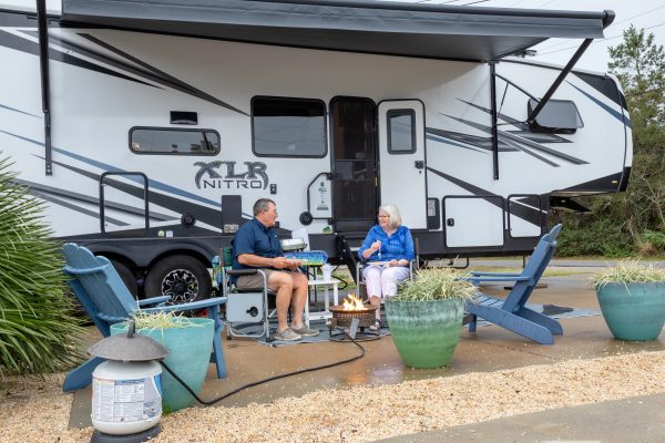 camping pros outside their RV