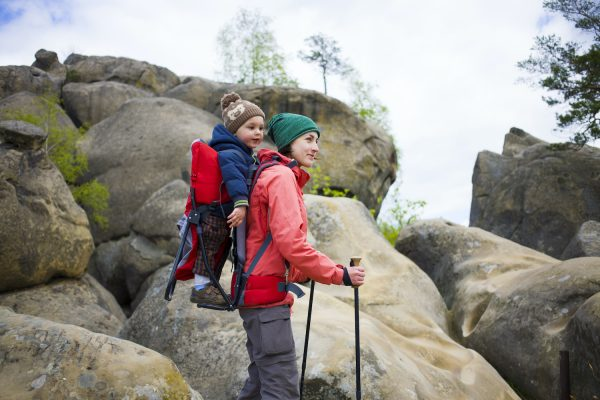 Child on carrier hiking mom