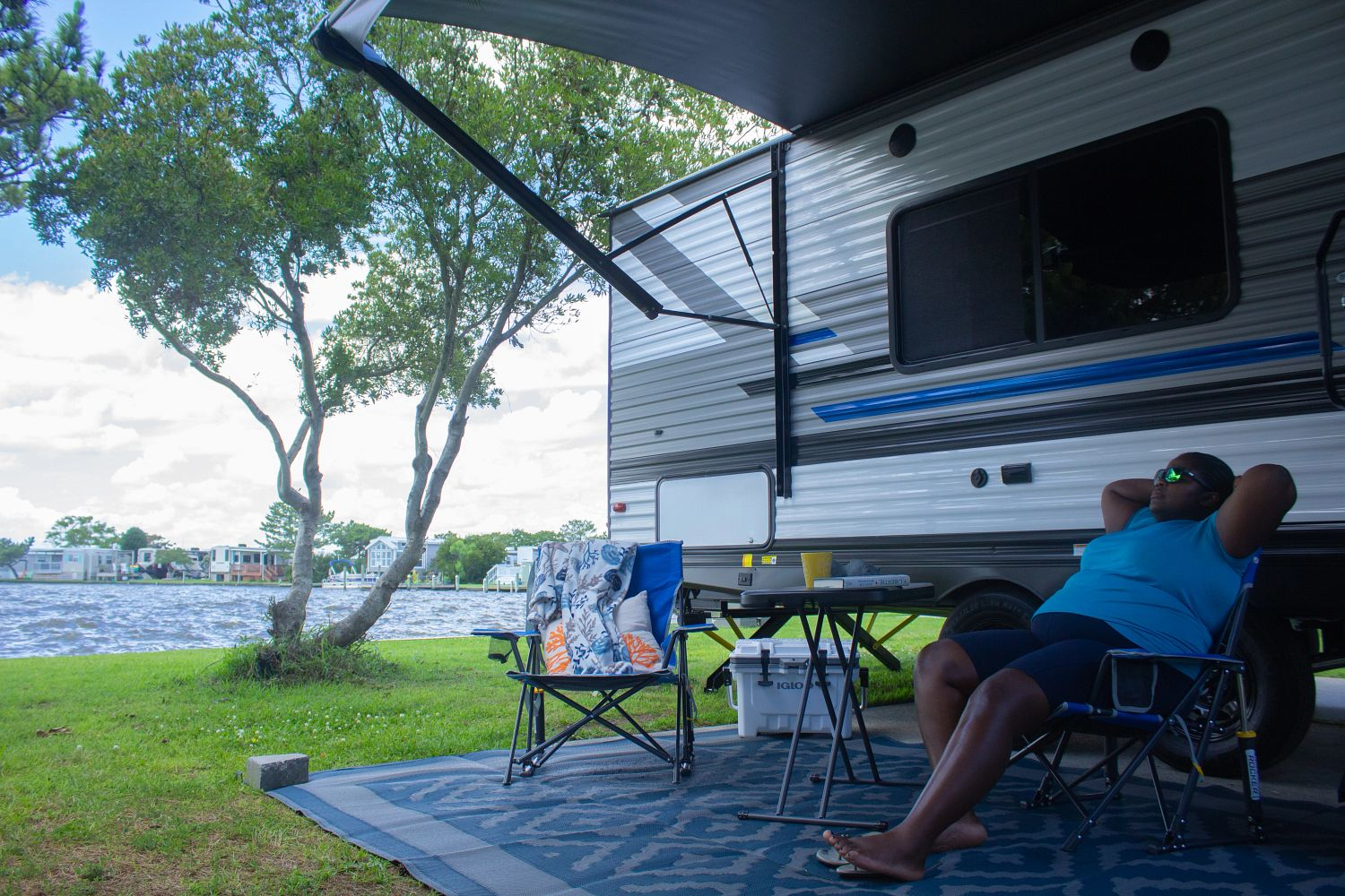 solo woman relaxing at campsite