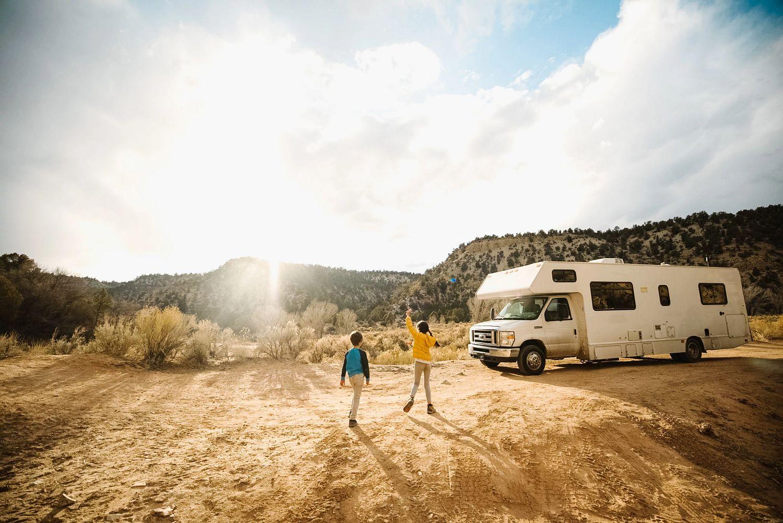 family hiking camping in desert summer