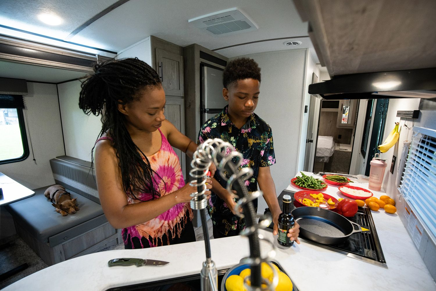 cooking home meals in RV kitchen