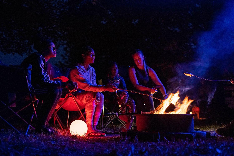 demetrius and family around campfire