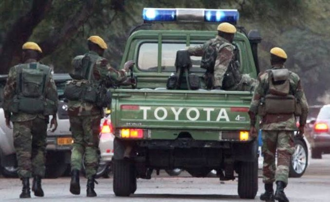 Soldiers assault police for not wearing face masks