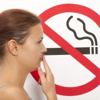 When can someone smoke after tooth extraction?
