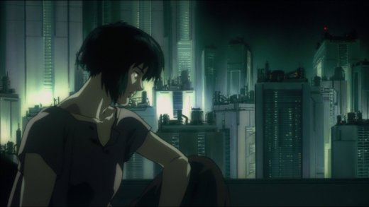 Motoko Kusanagi sits in bed. The city is outside her window.