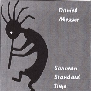 The cover of Sonoran Standard Time. Kokopeli dances and plays his flute.