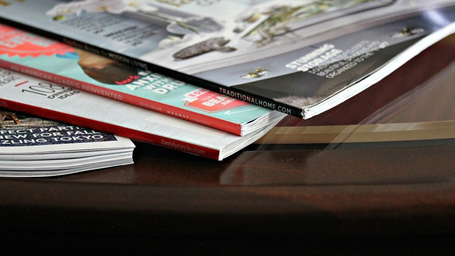 Stack of magazines laid out on a table