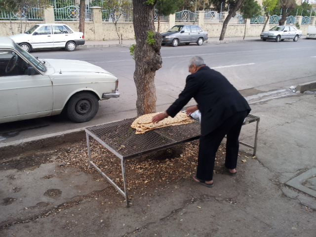 People flocked and after receiving their bread laid it out to cool.