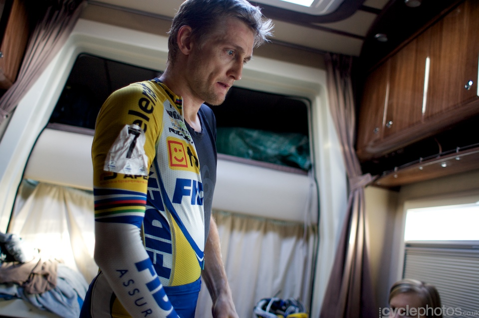 He puts on his skinsuit and his serious face as well.