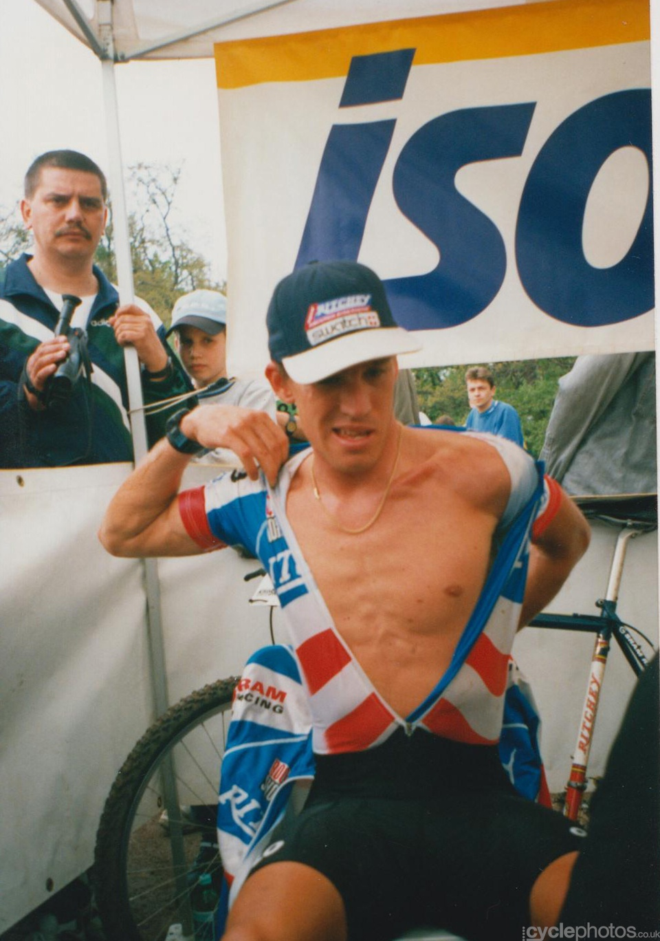 Frischi cleans himself up before the climbing on the top of the podium