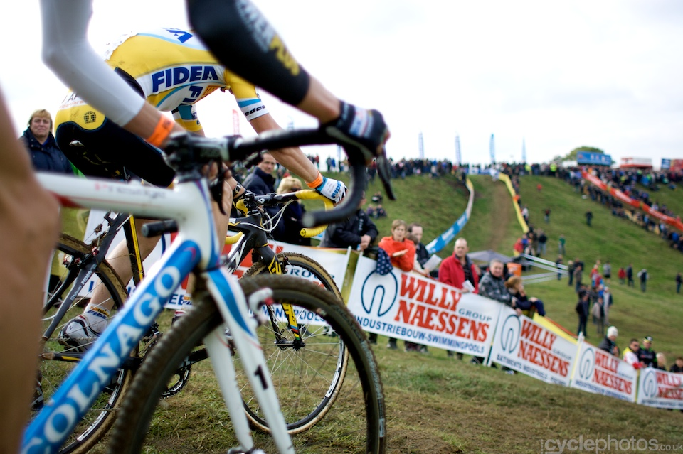 Three U23 riders start a steep descent during the first round of the Bpost Trofee cyclocross race in Ronse, Belgium.