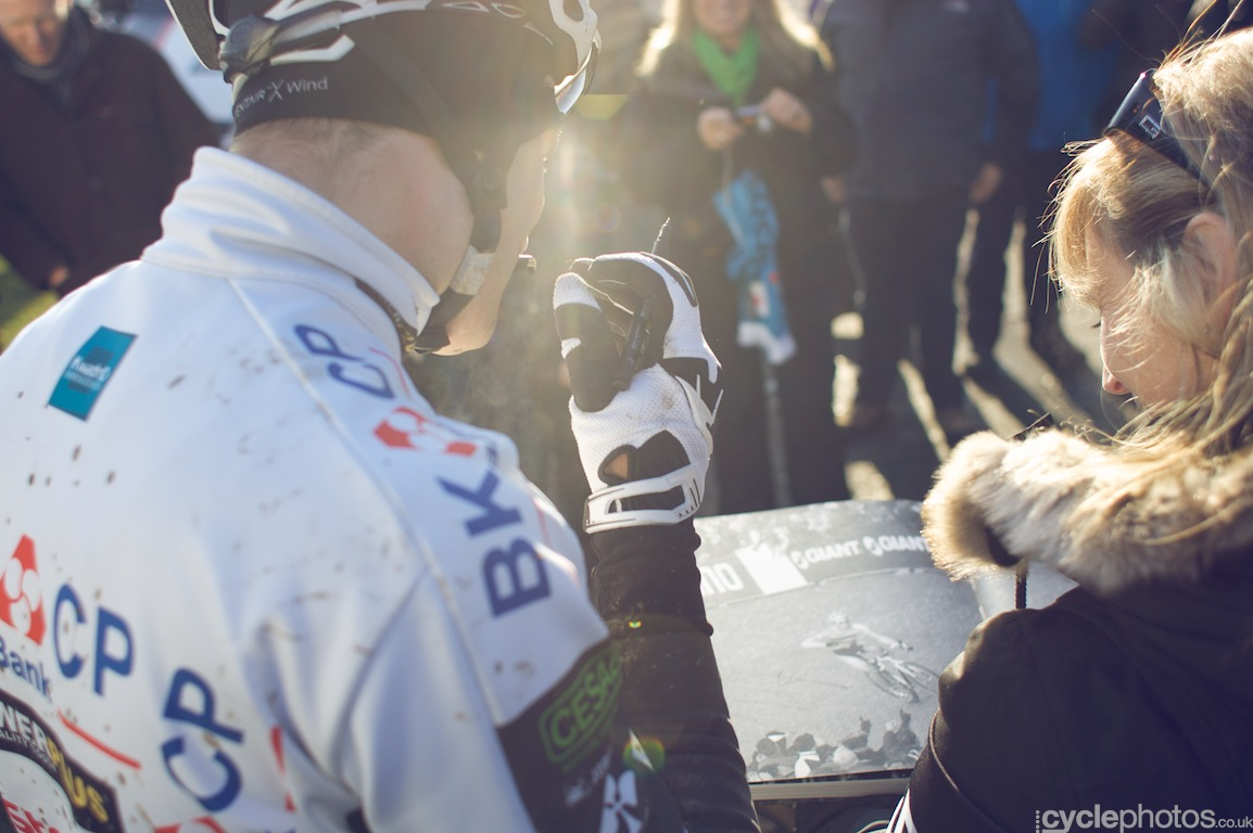 Niels Albert signs a book with a photo of him winning his first elite World Champion title in Hoogerheide, back in 2009
