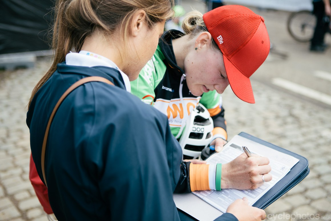 Elle Anderson signs the doping control form after the Bpost Bank Trofee cyclocross race in Ronse. Photo by Balint Hamvas / cyclephotos.co.uk