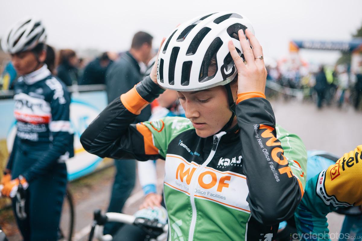Elle Anderson puts on her helmet before the Superprestige cyclocross race in Gieten, in 2014. Photo by Balint Hamvas / cyclephotos.co.uk