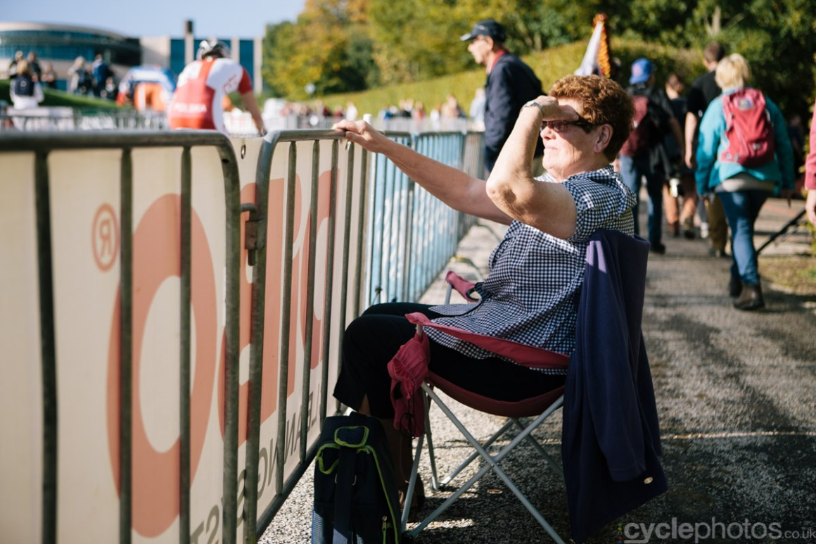 A spectator enjoys the racing and the wonderful weather at the first cyclocross World Cup race of the 2014/2015 season in Valkenburg.