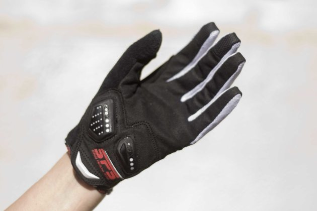 Gloves are a tight fit and require a hard pull to get them on
