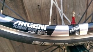 Silver Argent rims come with red Amercian Classic valve stems