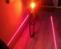 The standard LED light is plenty bright enough to be seen with, the lasers are to encourage other road users to give you some space