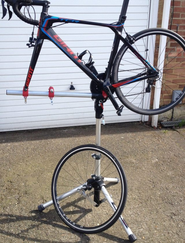 The Minoura RS1600 Workstand can hold your bike by either the front or rear wheel.