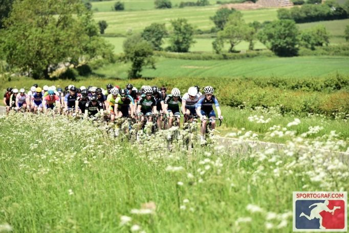 Early on and the route rolls through some pretty countryside. Photo courtesy of Sportograf