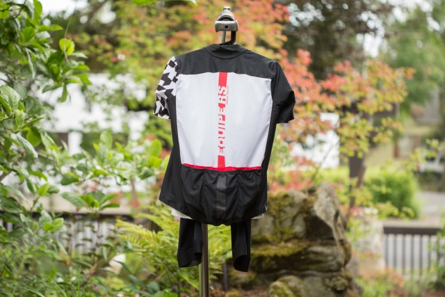 Back view of the Assos Equip RS aero jersey with an out of focus background