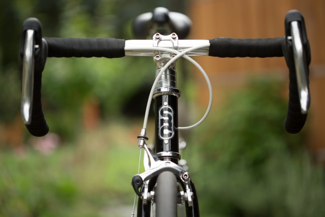 front view of a black State Bikes 4130 road bike in front of an out of focus background