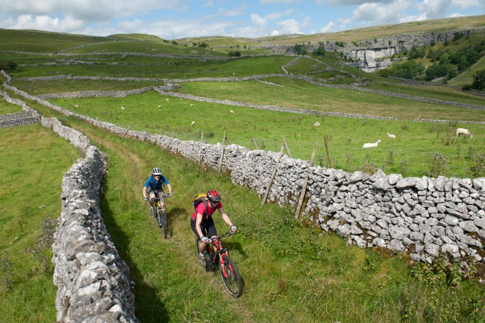Mountain biking with Malham Cove behind