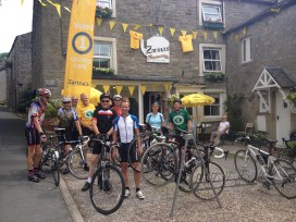 cyclists taking a break at Zarinas Café in kettlewell