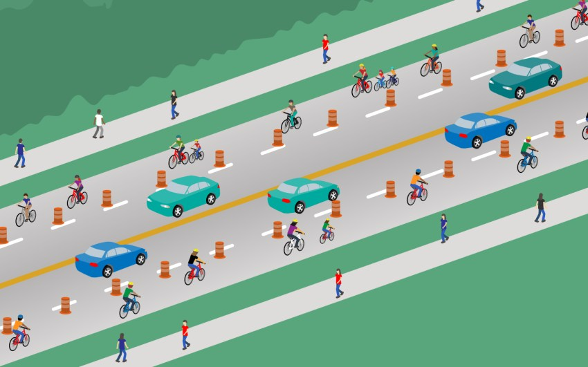 An illustration of what the temporary bike lanes look like. There is one lane of vehicular traffic in each direction and the outside lanes are marked with orange traffic cones to reserve it for bicycles.