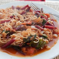 Stir Fried Laziness:  Beet Greens in Chili-Garlic Soy Bean Sauce with Tomatoes, Ginger and Noodles