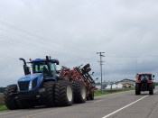 This tractor has more tires than all of the tires for the farmer I used to help, as a kid.