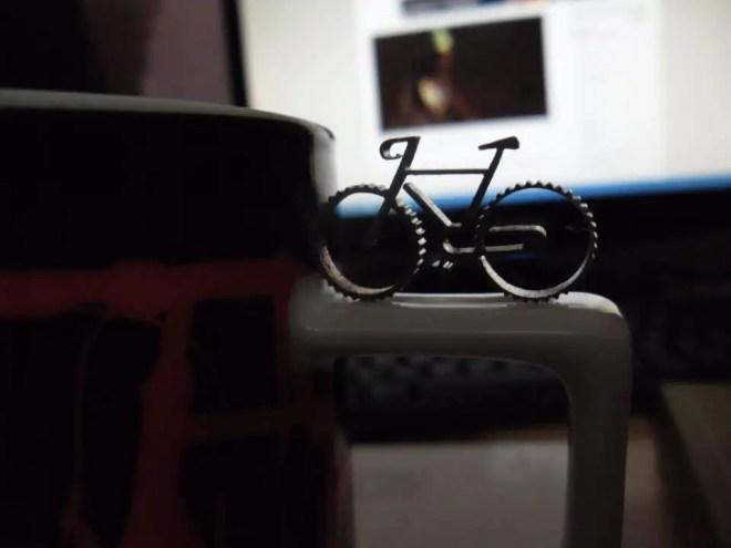 A micro bicycle and a mug