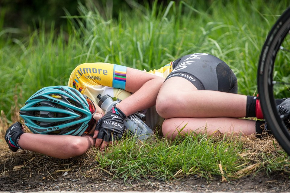 After the race, someone curled up in a ball in the grass, exhausted