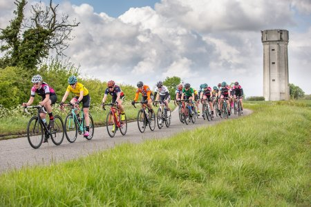 The peloton under the water tower near bedford