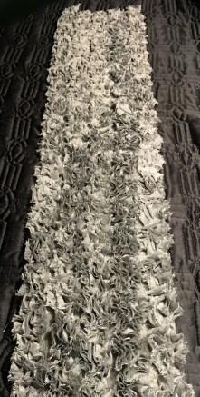 5 rows of fringe laying on the base