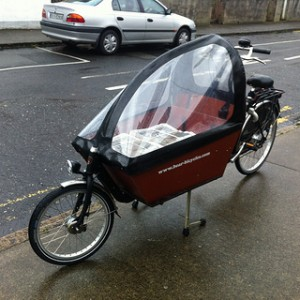 Bundles of the first edition loaded into a cargo bike