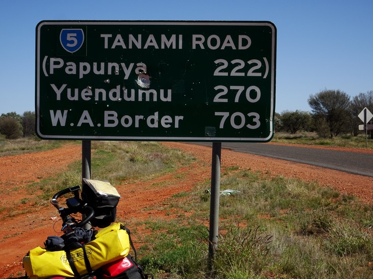 The border is 703 km away. That means like a 1000 to Halls Creek. Oh Boy, here I go